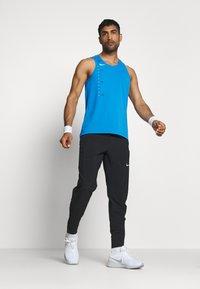 Nike Performance - DRY MILER TANK TECH - Camiseta de deporte - pacific blue/lemon - 1