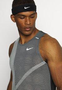 Nike Performance - RISE 365 TANK HYBRID - Sports shirt - black/grey fog/silver - 4