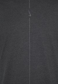 Nike Performance - DRY TEE YOGA - Basic T-shirt - black/iron grey - 3