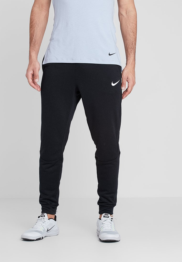 Nike Performance - DRY TAPERED PANT - Tracksuit bottoms - schwarz