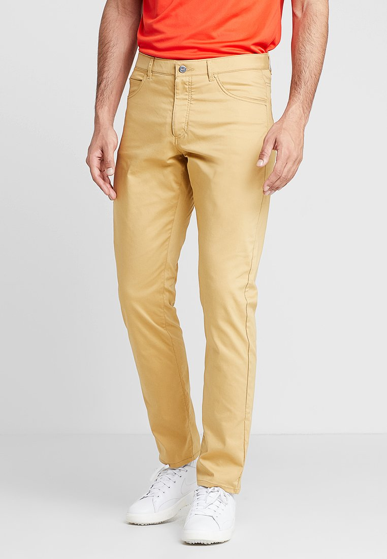 Nike Golf - FLEX PANT SLIM 5 POCKET - Friluftsbukser - club gold/wolf grey