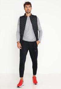 Nike Performance - PHENOM  - Pantalones deportivos - black/reflective black - 1