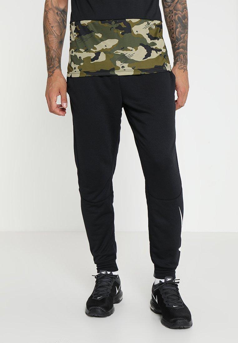 Nike Performance - DRY PANT TAPER  - Jogginghose - black/white