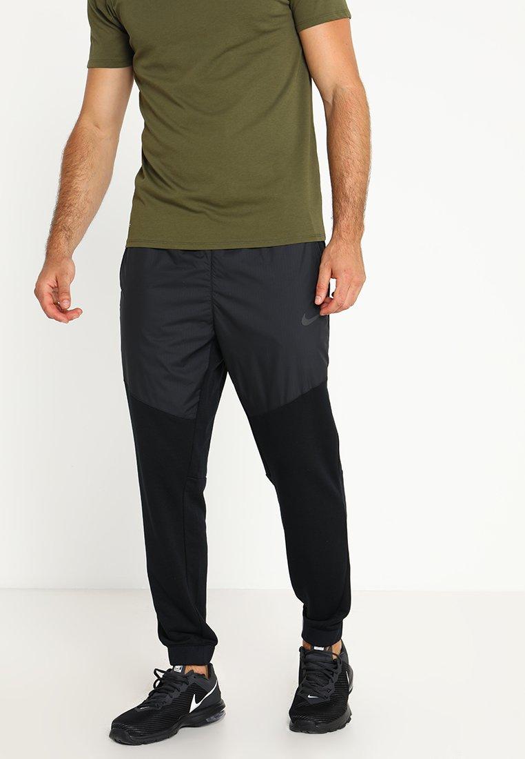 Nike Performance - DRY PANT UTILITY CORE - Tracksuit bottoms - black/metallic hematite