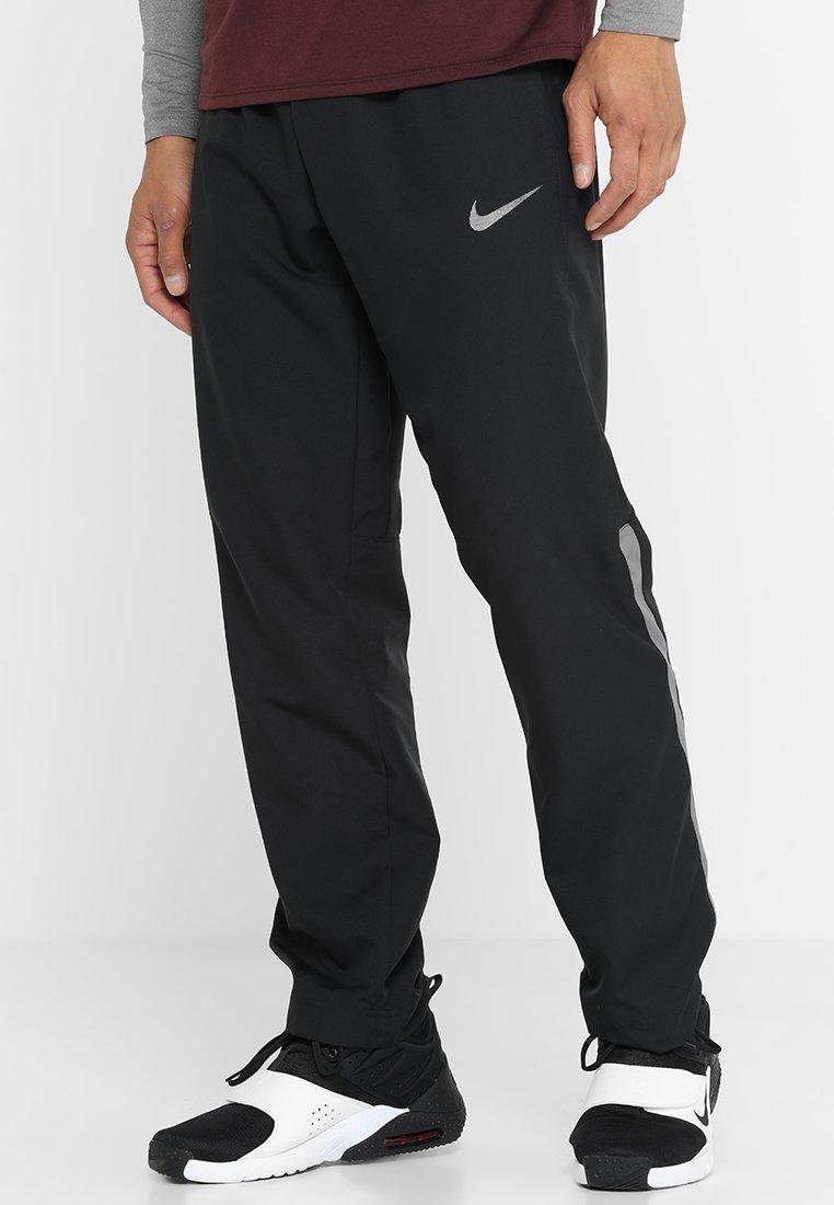 Nike Performance - DRY PANT TEAM - Tracksuit bottoms - black/metallic hematite