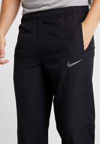 Nike Performance - DRY PANT TEAM - Träningsbyxor - black/hematite - 4