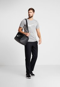 Nike Performance - DRY PANT TEAM - Träningsbyxor - black/hematite - 1