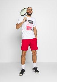 Nike Performance - DRY SHORT - Pantalón corto de deporte - gym red - 1