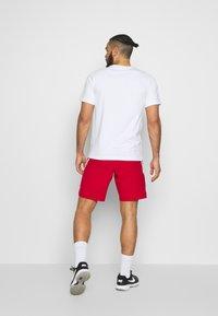 Nike Performance - DRY SHORT - Pantalón corto de deporte - gym red - 2