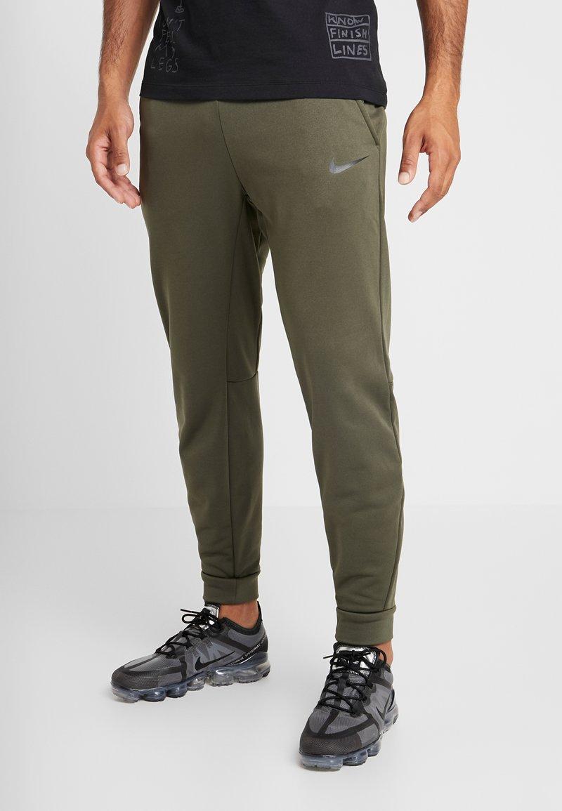 Nike Performance - PANT TAPER - Tracksuit bottoms - cargo khaki/black