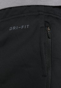 Nike Performance - THERMA SPHERE PANT - Jogginghose - black/anthracite/hematite - 6