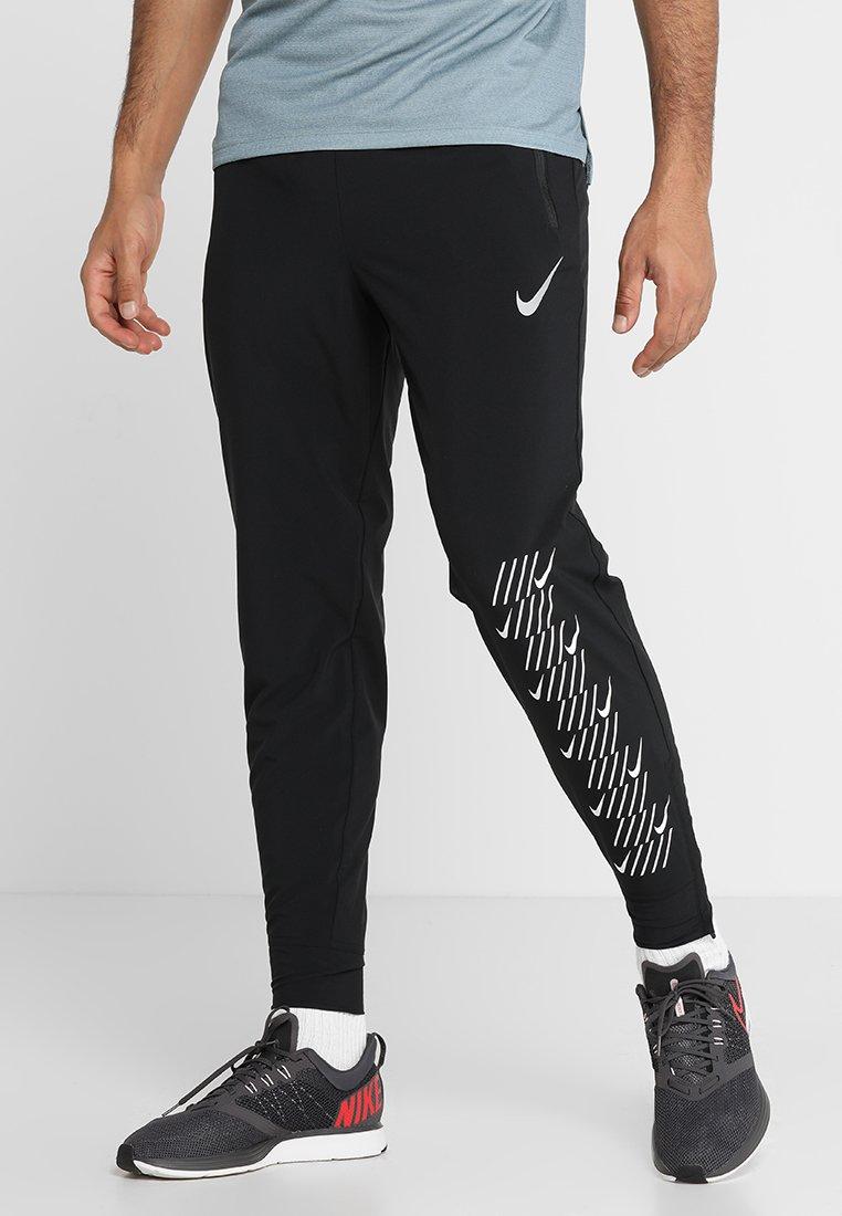 Nike Performance - PANT - Tracksuit bottoms - black/white