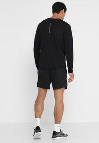 Nike Performance - SHORT - Sports shorts - black - 2