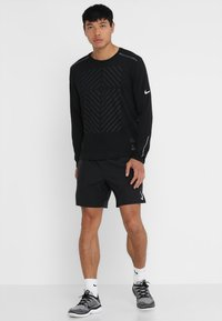Nike Performance - SHORT - Sports shorts - black - 1