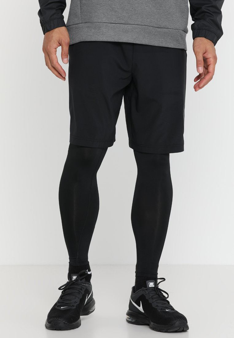 Nike Performance - TIGHT CMO - Tights - black