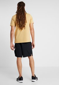 Nike Performance - DRY SHORT - Träningsshorts - black/white - 2