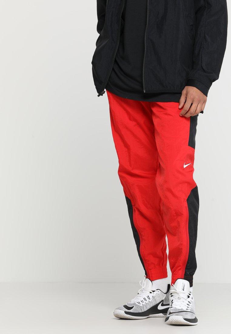 Nike Performance - RETRO PANT  - Tracksuit bottoms - university red/black