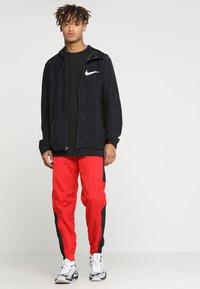 Nike Performance - RETRO PANT  - Tracksuit bottoms - university red/black - 1