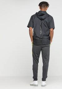 Nike Performance - DRY PANT - Verryttelyhousut - anthracite/opti yellow - 2