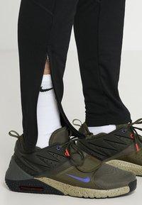 Nike Performance - DRY PANT - Pantalones deportivos - black/ember glow - 3