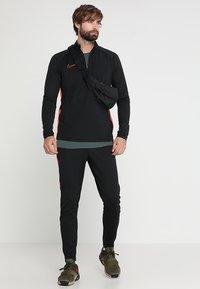 Nike Performance - DRY PANT - Pantalones deportivos - black/ember glow - 1