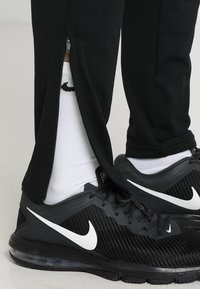 Nike Performance - DRY PANT - Joggebukse - black/white - 4