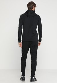 Nike Performance - DRY PANT - Joggebukse - black/white - 2