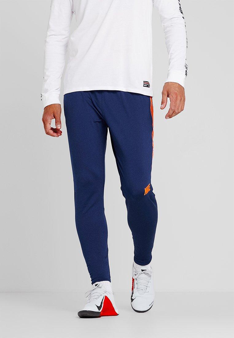 Nike Performance - DRY PANT - Jogginghose - blue void/total orange