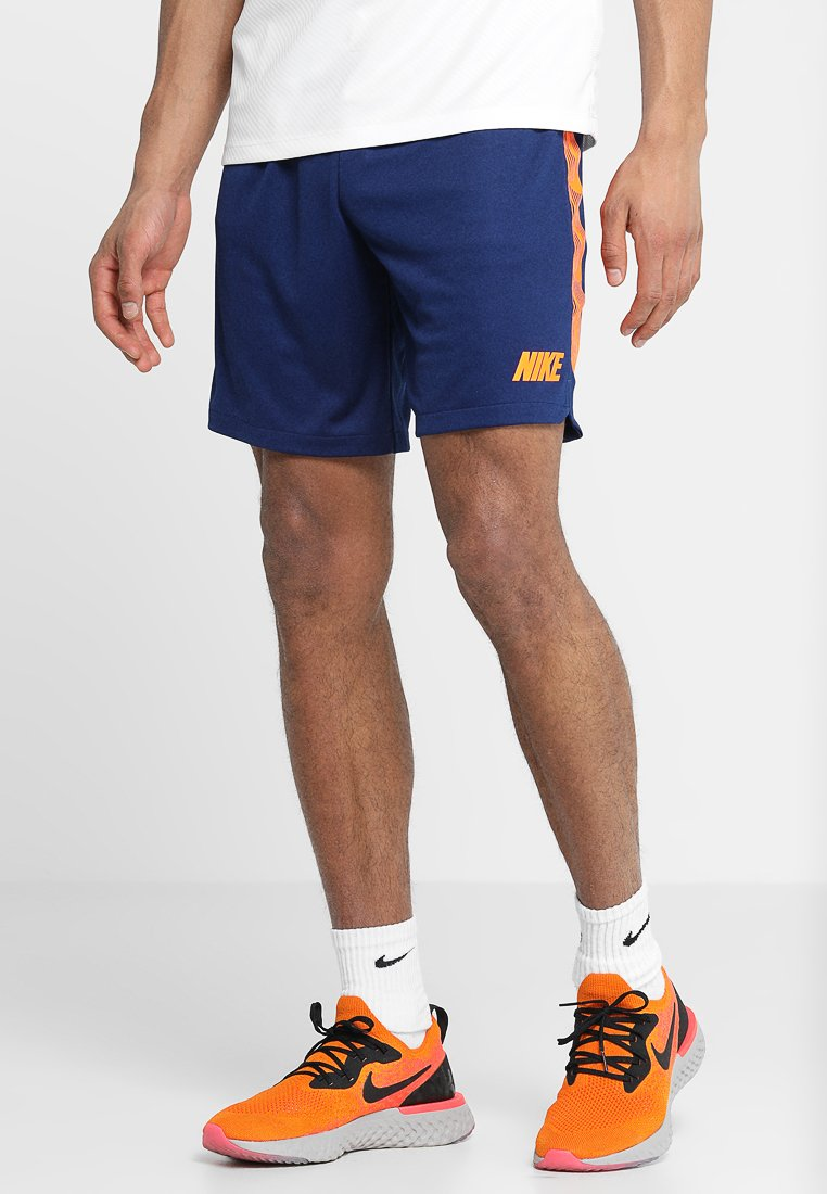 Nike Performance - DRY SHORT - Sports shorts - blue void/total orange
