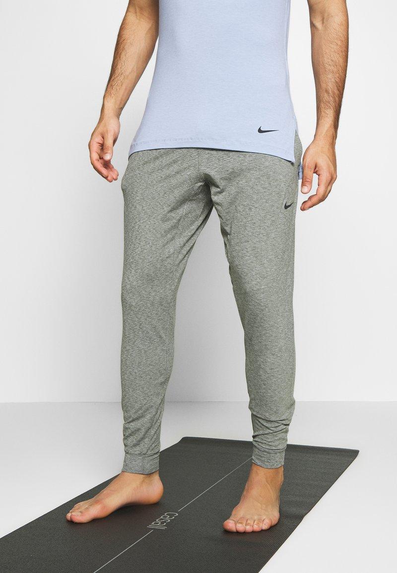 Nike Performance - M NK DRY PANT HPR DRY LT YOGA - Tracksuit bottoms - galactic jade/black