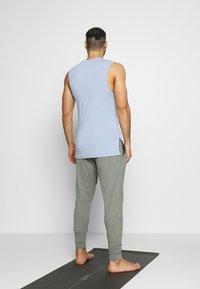 Nike Performance - M NK DRY PANT HPR DRY LT YOGA - Tracksuit bottoms - galactic jade/black - 2