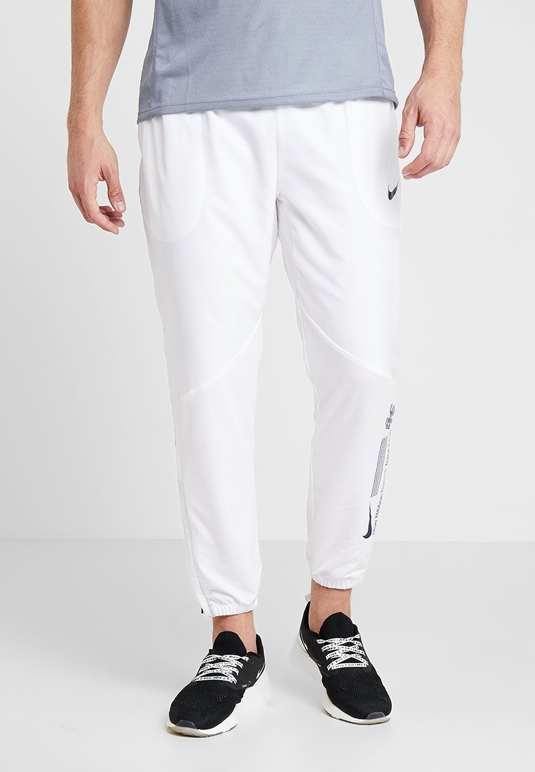 Nike Performance - TRACK PANT - Tracksuit bottoms - white/blue void
