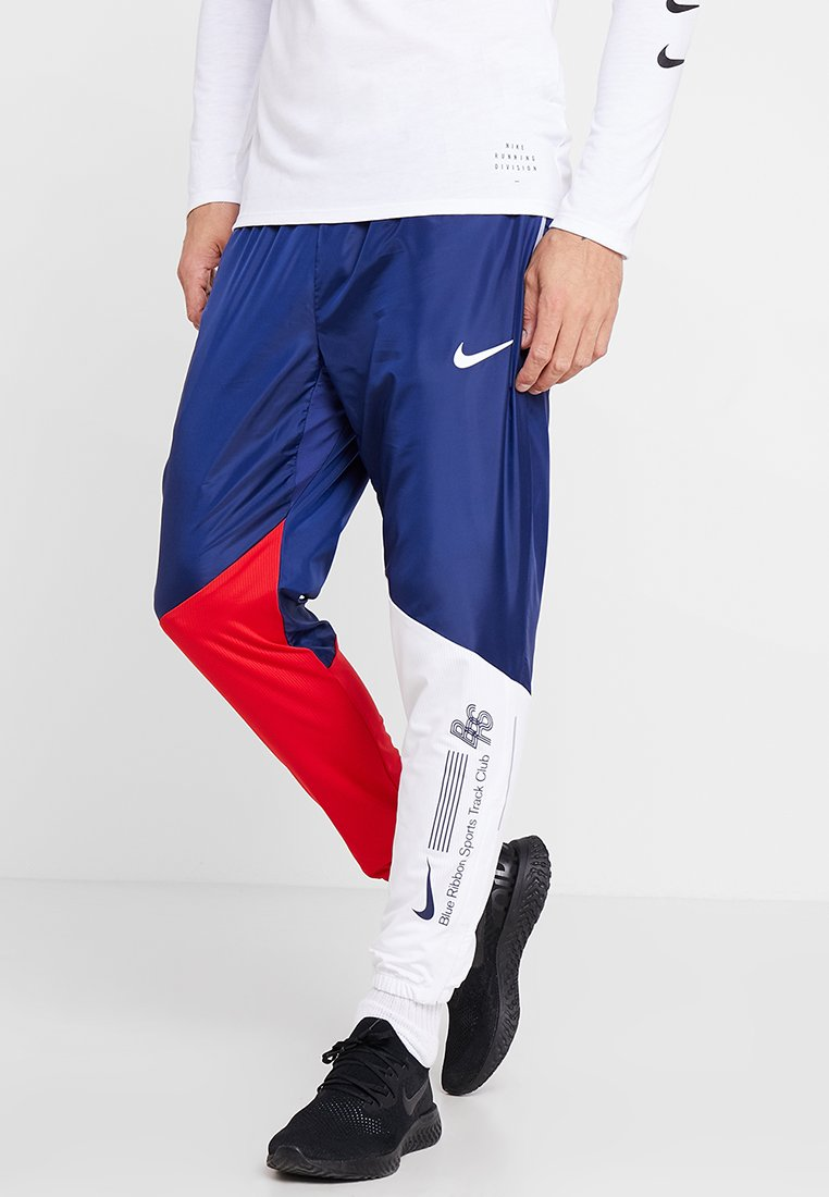 Nike Performance - TRACK PANT - Tracksuit bottoms - blue void/university red/white