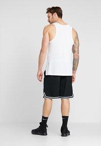 Nike Performance - DRY DNA SHORT 2.0 - Krótkie spodenki sportowe - black/white - 2