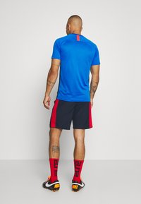 Nike Performance - DRY ACADEMY SHORT - Sports shorts - obsidian/university red/university red - 2