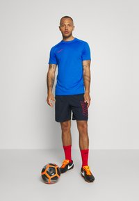 Nike Performance - DRY ACADEMY SHORT - Sports shorts - obsidian/university red/university red - 1