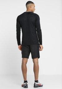 Nike Performance - DRY ACADEMY SHORT - Pantalón corto de deporte - black/white - 2