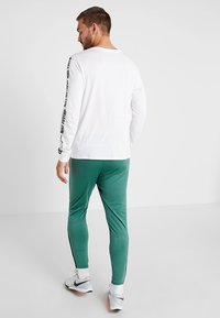 Nike Performance - FC PANT - Teplákové kalhoty - bicoastal/white - 0