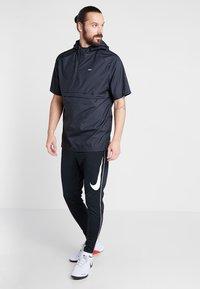 Nike Performance - FC PANT - Jogginghose - black/white - 1