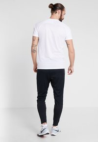 Nike Performance - FC PANT - Jogginghose - black/white - 2