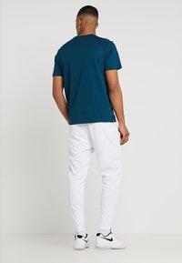 Nike Performance - PANT - Pantalon de survêtement - white - 2