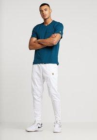 Nike Performance - PANT - Pantalon de survêtement - white - 1