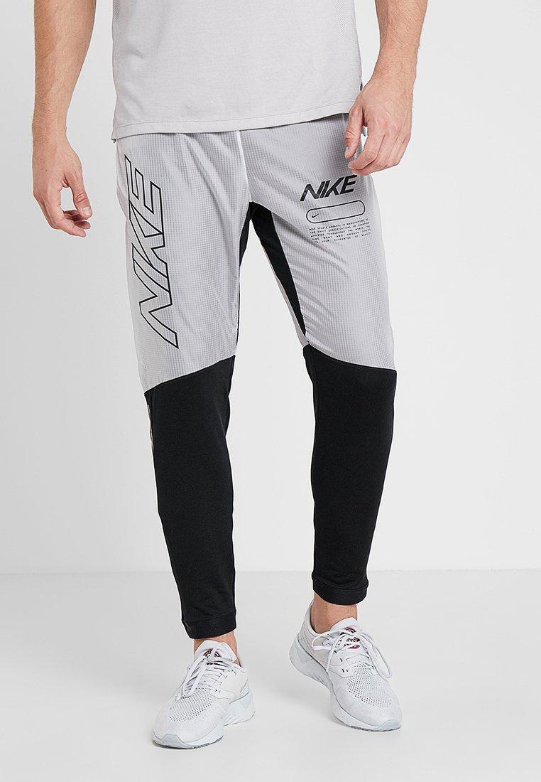 Nike Performance - ELITE TRACK PANT AIR - Jogginghose - black/white
