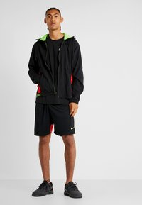 Nike Performance - DRY SHORT HYBRID - Sports shorts - black/habanero red/electric green - 1