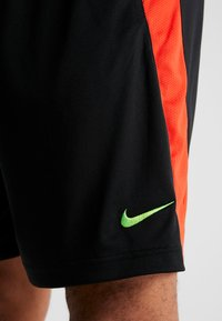 Nike Performance - DRY SHORT HYBRID - Sports shorts - black/habanero red/electric green - 3
