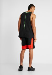 Nike Performance - DRY SHORT HYBRID - Sports shorts - black/habanero red/electric green - 2