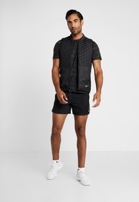 Nike Performance - FLEX STRIDE SHORT - Sports shorts - black/silver - 1