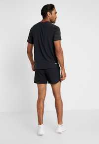 Nike Performance - FLEX STRIDE SHORT - Sports shorts - black/silver - 2