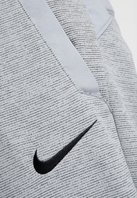 Nike Performance - DRY PLUS - Tracksuit bottoms - particle grey/heather/black - 6