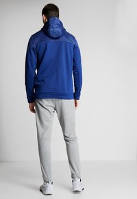 Nike Performance - DRY PLUS - Tracksuit bottoms - particle grey/heather/black - 2